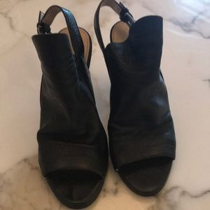 Black leather high-heeled mules
